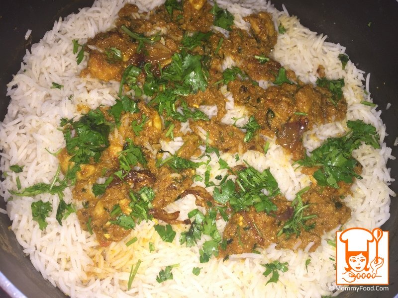 Then add remaining curry, coriander leaves and fried onion. Spread all over