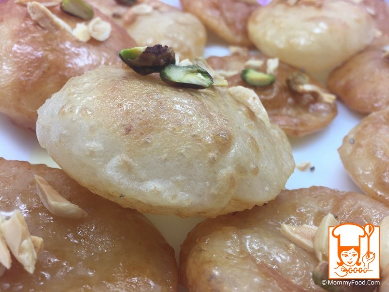 Sweet poori is prepared with all purpose flour and suji. This is a variety snack which kids will like to eat. Here are the step by step instructions.