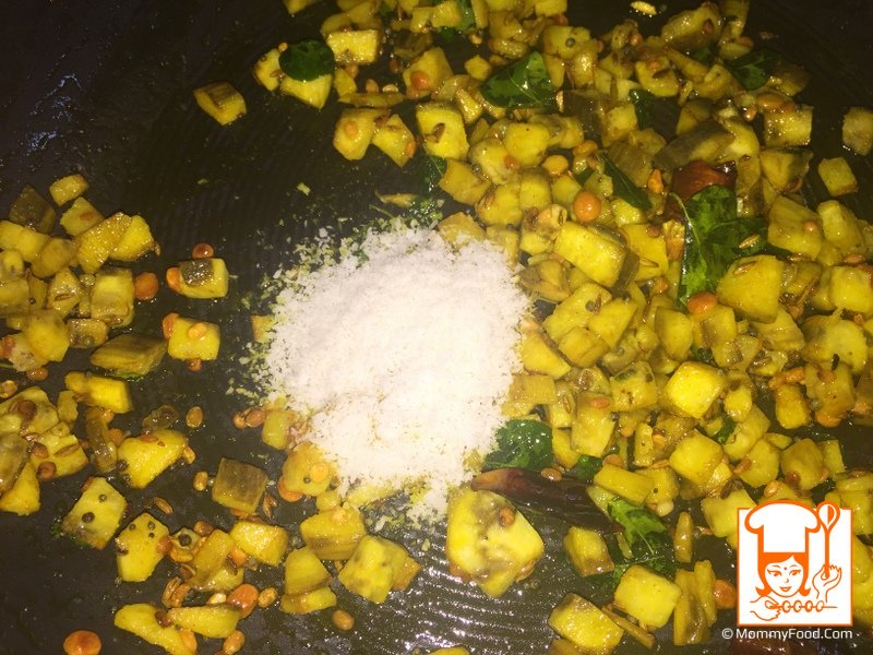 Add dry coconut powder and stir-fry for a minute