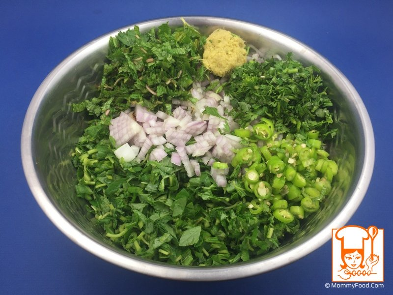 Step 4: In a mixing bowl, add chopped amaranth leaves, coriander leaves, curry leaves, mint leaves, green chillies, ginger garlic paste. Mix thoroughly