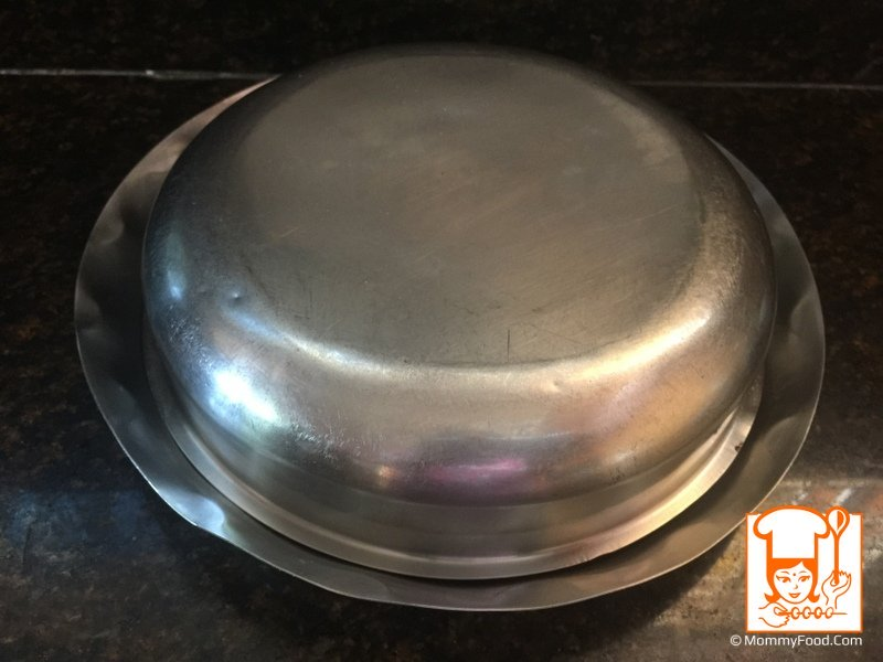 Carefully take out the cake tin, and turn out on a plate