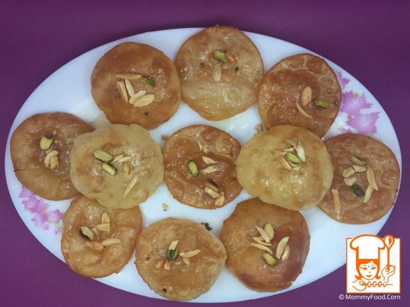 Step 6: Layout sweet poori's on a plate and garnish them with fried cashews, almonds and pista