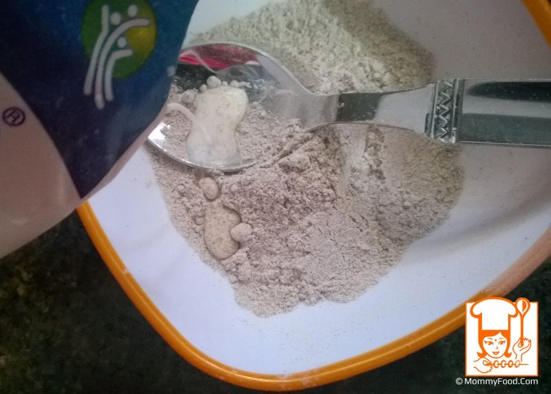 Step 3: Add 50 ml of milk(for 12+ month baby) or water(for 6 to 12 month baby) to ragi powder, mix thoroughly until no lumps are formed